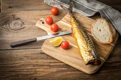Smoked mackerel and bread. stock photos