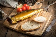Smoked mackerel and bread. royalty free stock image