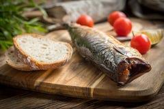 Smoked mackerel and bread. royalty free stock photo