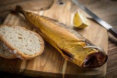 Smoked mackerel and bread. royalty free stock photos
