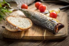 Smoked mackerel and bread. royalty free stock images