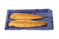 Smoked mackerel in a carton. Smoked mackerel fillets in a plastic carton isolated against white royalty free stock image