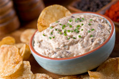 Smoked Mackerel Dip. A bowl of delicious homemade smoked mackerel dip with caramelized onions and smoked paprika stock photo