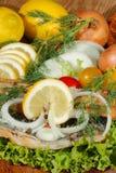 Smoked mackerel fillet with salad, lemon, onions, tomato Royalty Free Stock Photography