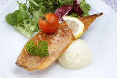 Smoked mackerel fillet with tomato Royalty Free Stock Photography