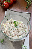 Smoked mackerel pate with eggs and herbs in glass bowl Royalty Free Stock Photo