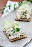 Smoked mackerel pate with herbs on crisp bread Stock Images