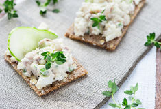 Smoked mackerel pate with herbs on crisp bread Stock Photography