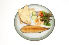 Smoked mackerel and salad. On a plate isolated against white royalty free stock images