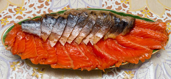Smoked mackerel and trout cut on a platter Royalty Free Stock Image