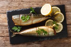 Free Smoked Mackerel With Lemons And Parsley Closeup On A Slate Board On The Table. Horizontal Top View Royalty Free Stock Images - 138828699