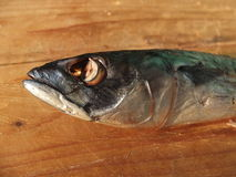 Smoked mackerel on wooden table Royalty Free Stock Images