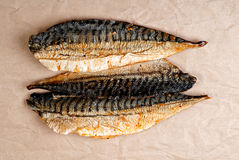 Smoked mackerel. On wrapping paper Royalty Free Stock Photo
