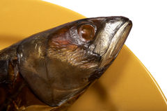 Smoked mackerel. On a yellow plate Stock Image