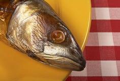 Smoked mackerel. On a yellow plate. Horizontal position royalty free stock image