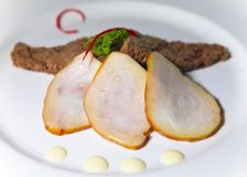Smoked marlin and roasted bread on plate.  Stock Images