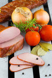 Smoked meat. Apple wood smoked pork loins. Sliced meat and vegetables. Sliced smoked pork. Electric smoker. Wood smoked meat stock images