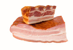 Smoked meat, clipping path included. Two pieces of ham and bacon with clipping path Royalty Free Stock Photos