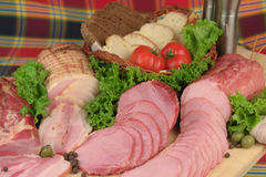 Smoked meat products. Smoked Ham smoked bacon with greens & vegetables royalty free stock image