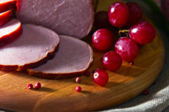Smoked meat and red grape Royalty Free Stock Photos