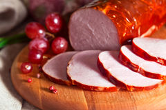 Smoked meat and red grape Stock Photos
