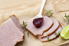 Smoked meat, rosemary, home made organic cherry confiture and lime Stock Image