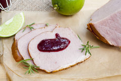 Smoked meat, rosemary, home made organic cherry confiture and lime Royalty Free Stock Photo