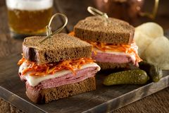 Smoked Meat on Rye Sandwich. With melted swiss cheese and coleslaw tossed in russian dressing Royalty Free Stock Image