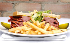Smoked meat sandwich with frys and ceasar Stock Images