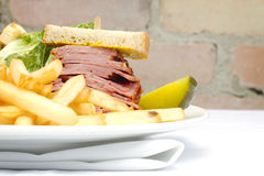 Smoked meat sandwich with frys and ceasar Royalty Free Stock Image