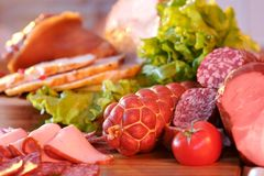Smoked meat sausage and salad. Still life with meat fruit and vegetables in Caucasian style Stock Images