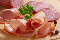 Smoked meat slices and salami Stock Photos