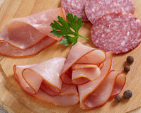 Smoked meat slices and salami Royalty Free Stock Photos