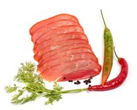 Smoked meat slices and spices Stock Images