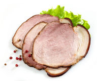 Smoked meat slices. On white background Royalty Free Stock Photography