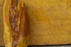 Smoked meat whole piece on a cutting board stock photography