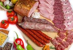 Smoked meat on wood  white background Stock Photo