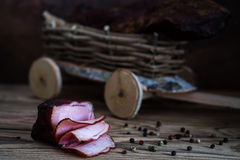 Smoked meat on wooden background Stock Photos