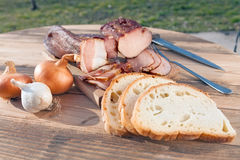 Smoked meat on wooden board VI Stock Images