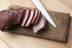 Smoked meat on wooden cutting board Royalty Free Stock Photo