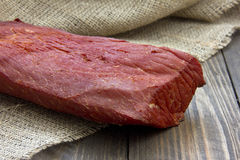 Smoked meat. On a wooden table in the early morning Royalty Free Stock Images