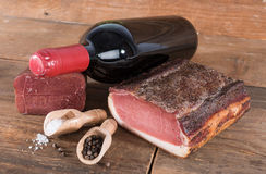 Smoked meats with a bottle of wine Stock Photography
