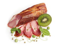 Smoked neck decorated with kiwi and green pea... Royalty Free Stock Images