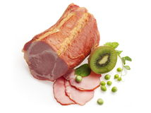 Smoked neck decorated with kiwi and green pea. Over white background Stock Images