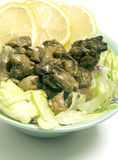 Smoked oyster salad  lemon slices lettuce Stock Photos
