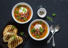 Smoked Paprika Lentil Soup In The Pan With Grilled Cheese Sandwiches And Crispy Bacon On A Dark Background, Top View. Delicious Co Royalty Free Stock Photo
