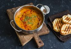 Smoked paprika vegetarian lentil soup with grilled cheese sandwiches a dark background, top view. Delicious comfort food concept. Flat lay Stock Image