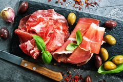 Smoked parma ham. On the black board stock image