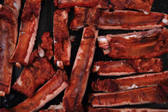 Smoked pig ribs background Royalty Free Stock Image