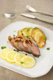 Smoked pink salmon with lemon and potato chips Royalty Free Stock Photography